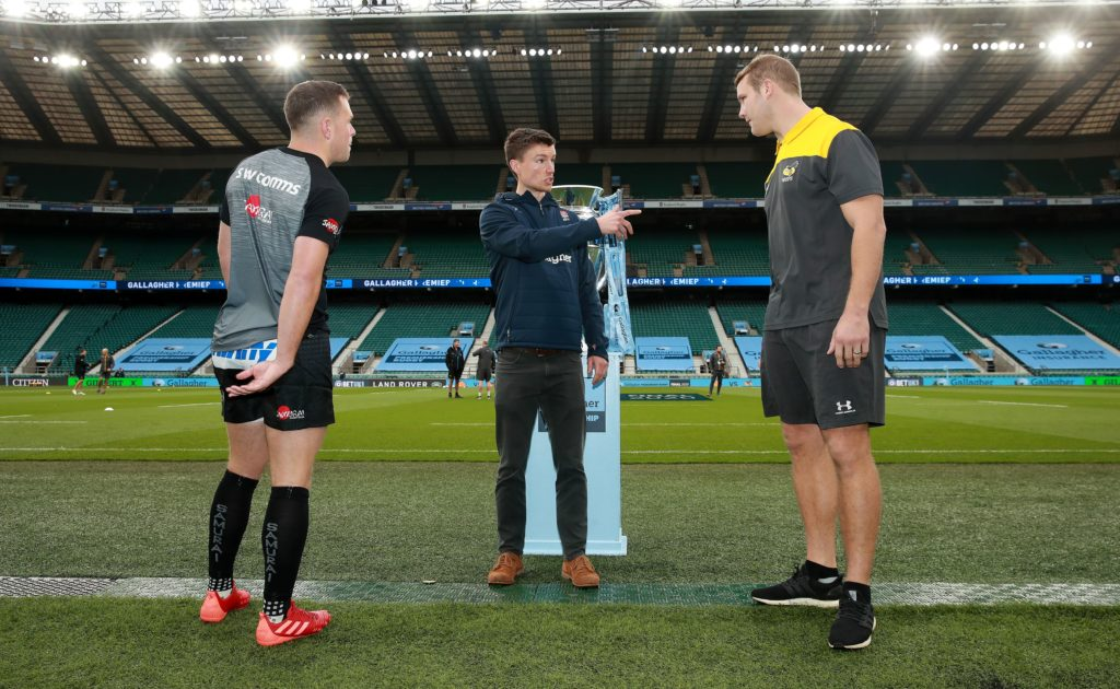 Craig Maxwell-Keys conducts the coin toss between <a href=