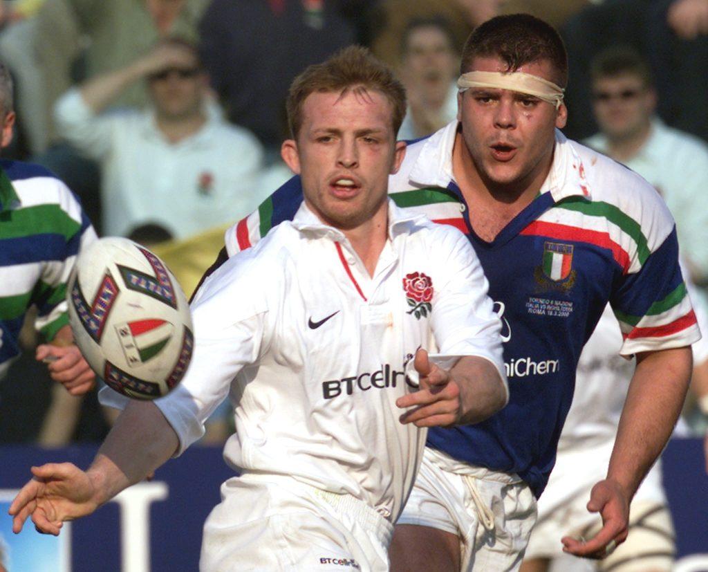 Italy's Andrea Lo Cicero closes in on England scrum-half Matt Dawson