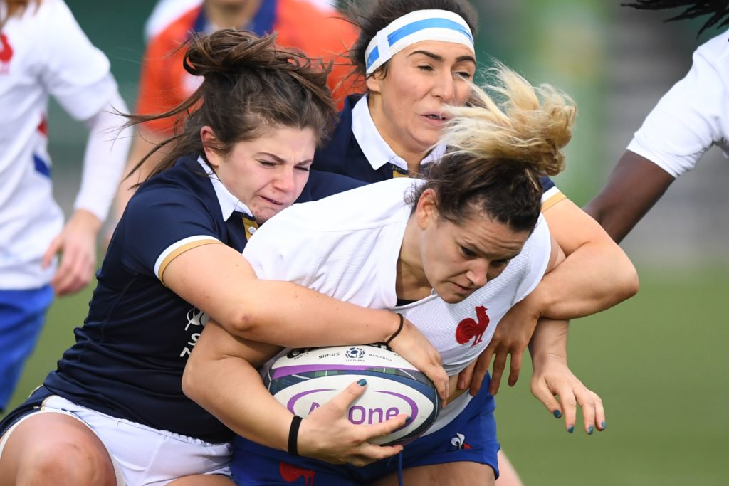 Lise Arricastre of France is tackled b Scotland's Lisa Thomson