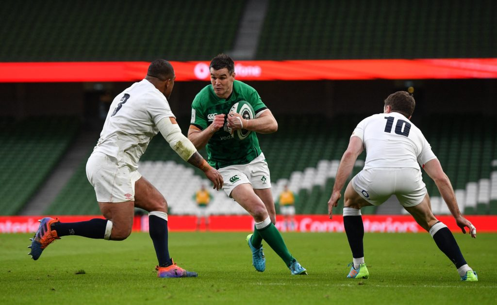 Johnny Sexton of Ireland carries ball at the English defence