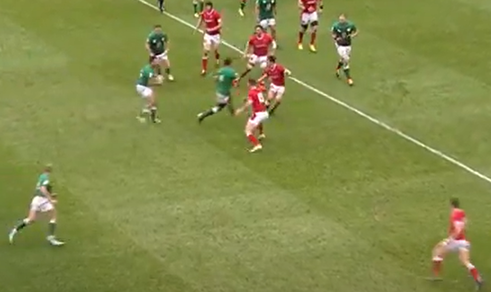 George North rushes up to defend