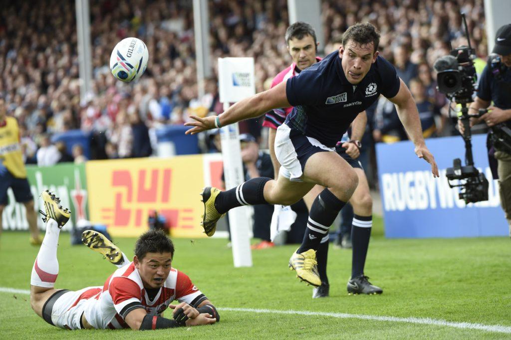 John Hardie of Scotland throws an offload against Japan