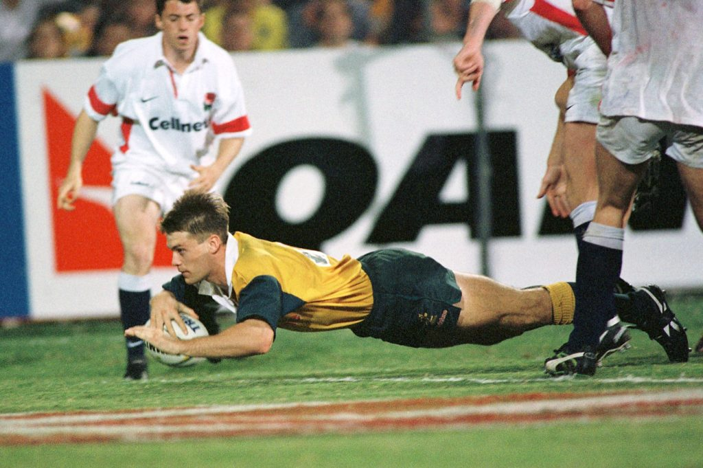 Ben Tune of Australia scores a try against England