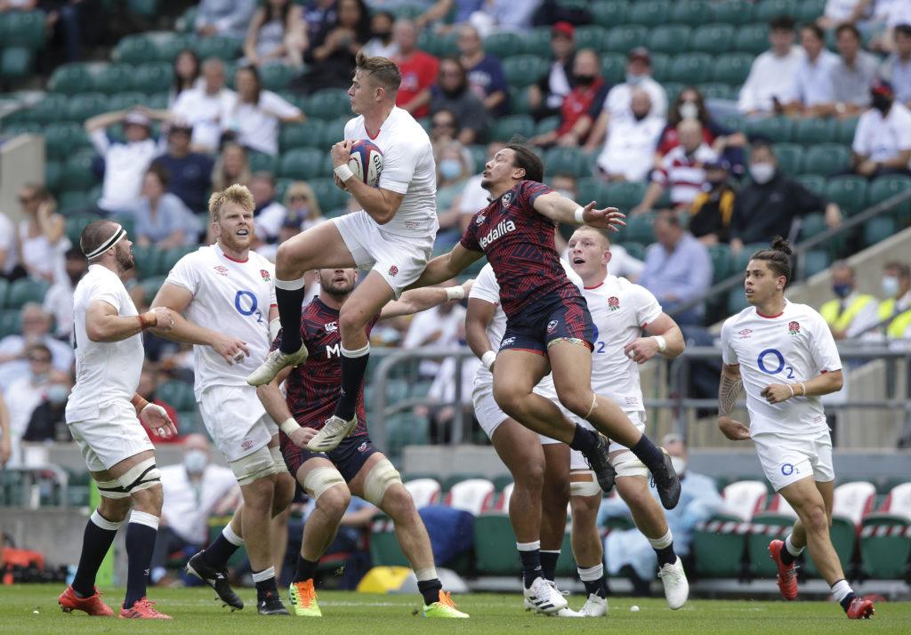 Freddie Steward of England leaps to claim a high ball against USA