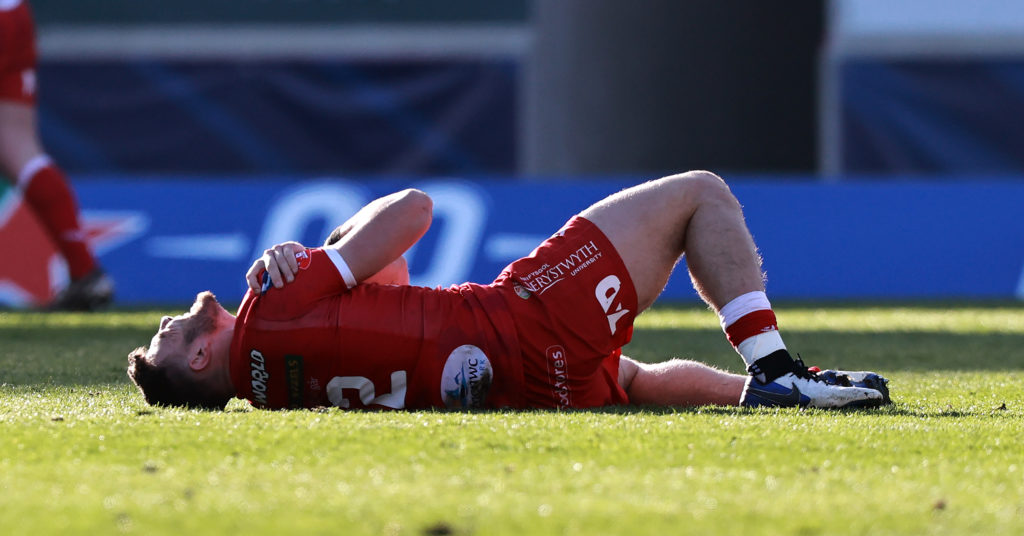 Johnny Williams lies in pain after injuring his shoulder on duty for Scarlets against <a href=